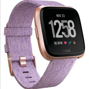 Brand new, never worn, never opened Fitbit Versa